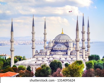 Aerial View of Sultan Ahmed Mosque, with sightseeing airplane flying overhead - Istanbul, Turkey