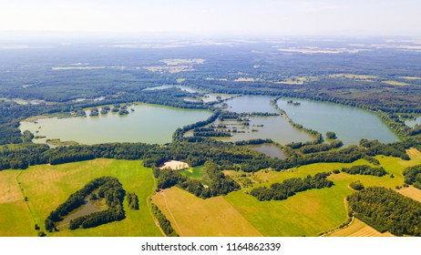 Aerial view of summer countryside with many lakes for common carp breeding in South Bohemia. Famous tourist landscape from above. South Bohemia in Czech republic, European union.