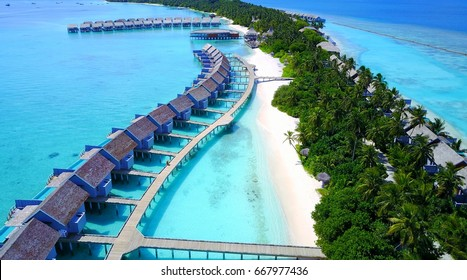 Aerial view of summer water bungalow and blue sea in a paradise island in Maldives