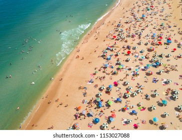 Aerial view of sunbathers and umbrellas on the beach at the Jersey shore