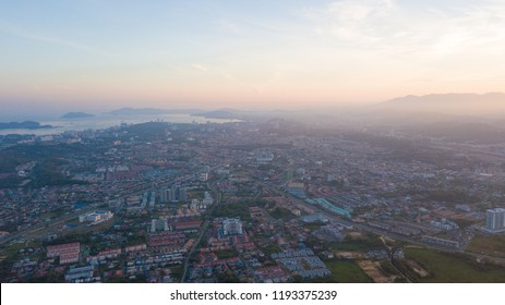 Aerial view of sunrise in Kota Kinabalu City, Sabah Malaysia. View from Cybercity Apartment, Kepayan, Kota Kinabalu, Sabah. Borneo. Malaysia.