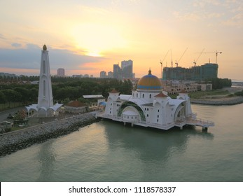 Aerial view of sunrise at Malacca Straits Floating Mosque or Masjid Terapung Selat Melaka