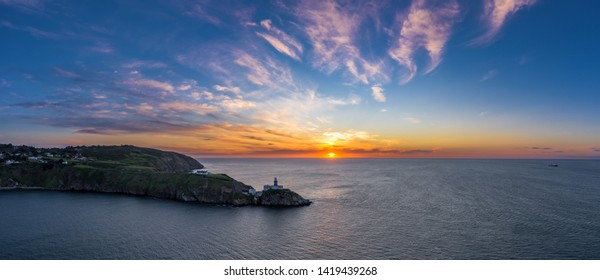 Aerial view of the sunrise over Baily lighthouse in Howth, Ireland.