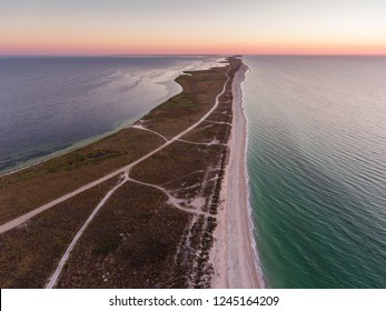 Aerial view of a sunrise over Byriuchyi Island - spit between Azov Sea and Utljuk Lyman , Azov-sivash national park, Kherson Oblast, Ukraine