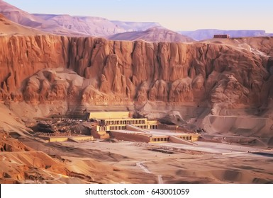 Aerial view at sunrise of Queen Hatshepsut mortuary temple and the red cliffs of the western bank of the Nile river, Luxor, Egypt