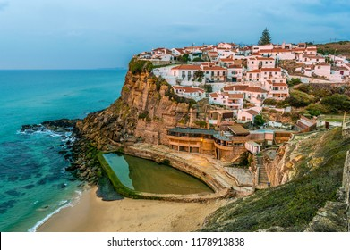 Aerial view at sunset of the Azenhas do Mar seaside town, in the municipality of Sintra, Portugal.