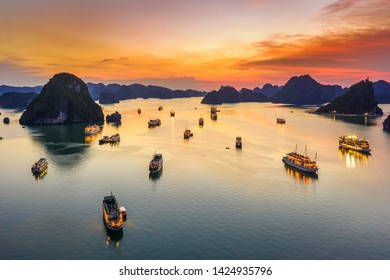 Aerial view of sunset and dawn near rock island, Halong Bay, Vietnam, Southeast Asia. UNESCO World Heritage Site. Junk boat cruise to Ha Long Bay. Popular landmark, famous destination of Vietnam - Shutterstock ID 1424935796