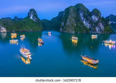 Aerial view of sunset, dawn near Ti Top rock island, Halong Bay, Vietnam, Southeast Asia. UNESCO World Heritage Site. Junk boat cruise to Ha Long Bay. Popular landmark, famous destination of Vietnam