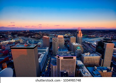 An aerial view of sunset in downtown Cincinnati along the Ohio River.