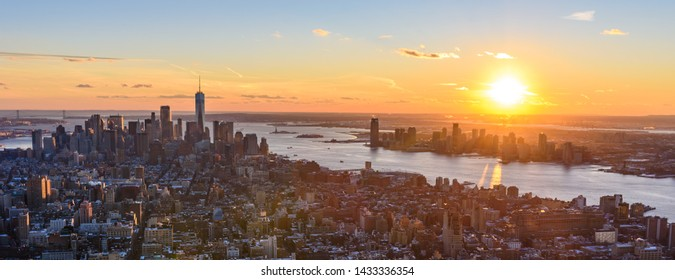 Aerial View at sunset of Lower Manhatten Downtown, New York City, USA