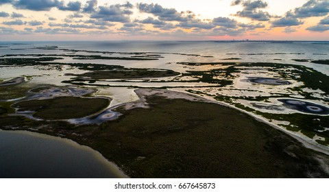 Aerial view sunset on the horizon above wetlands coastal waterways on Padre Island near Corpus Christi Texas a nature escape