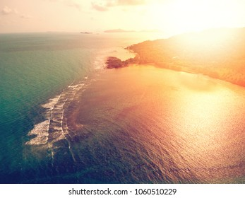 Aerial view of sunset over emerald tropical sea