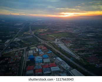 Aerial view of sunset over a highway in Shah Alam, Malaysia.