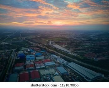 Aerial view of sunset over Industrial Estate and long highway in Shah Alam, Malaysia.