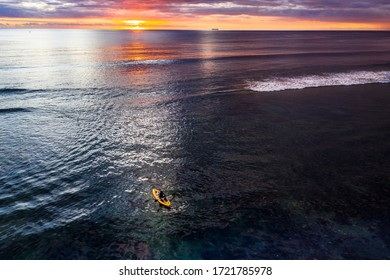 Aerial view: Sunset with a paddle boat on the coast of Flic en Flac, Mauritius, Africa