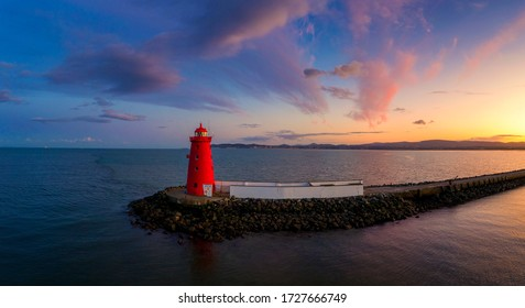 Aerial view Sunset Poolbeg lighthouse in Ireland, Dublin bay Pier to Poolbeg Lighthouse in Ireland