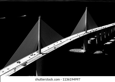 Aerial view of the Sunshine Skyway Bridge that spans Pinellas County and Manatee County in west central Florida.  Image was captured from a helicopter and converted to black and white.