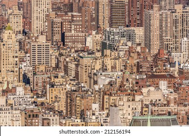 Aerial view of the super crowded, populated, and busy New York city in the USA showcasing the sea of historic and ancient buildings that characterize its world wide known architecture.