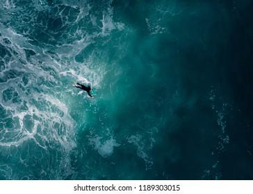 Aerial view of a surfer in the Atlantic Ocean