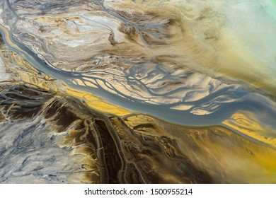 Aerial view of surrealistic industrial place. Human impact on the environment..Degraded landscape.Destroyed land.View from above.