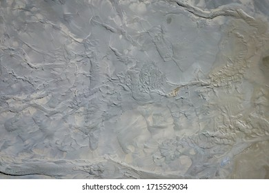 Aerial view of surrealistic industrial place. Dry surface. Desertic landscape. Human impact on the environment. View from above. Abstract industrial background. Photo made by drone.