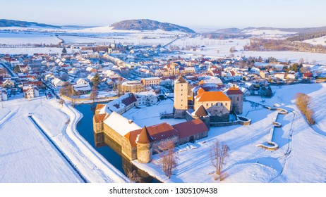 Aerial view of Svihov water castle in winter. Gothic stronghold in snowy landscape, national park Sumava, Czech republic, European union.