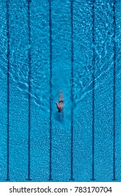 Aerial view of a swimming pool, with a person swimming