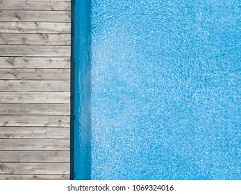 aerial view of swimming pool with wooden plank board