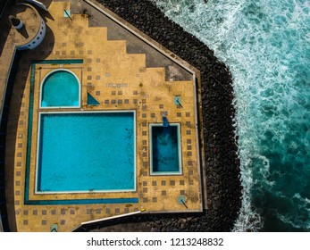 Aerial view from swimming pools near the ocean. Drone shot