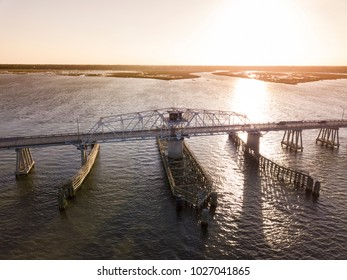 Aerial view of swing draw bridge over water near Beaufort, South Carolina at sunrise.