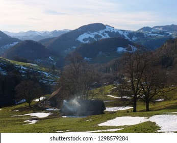 Aerial view of Swiss Jura hills with some snow from Belchenfluhe towards Langenbruck. CH Switzerland