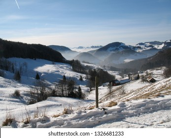 Aerial view of Swiss Jura hills with much snow from Belchenfluhe towards Langenbruck. CH Switzerland