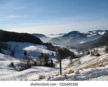 Aerial view of Swiss Jura hills with much snow from Belchenfluhe towards Langenbruck. CH Switzland