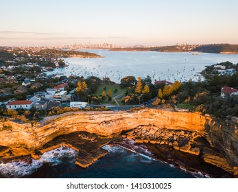 Aerial view of Sydney coastline with CBD skyline on the background.