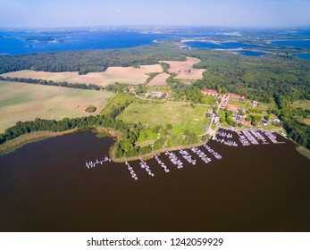 Aerial view of Sztynorckie Lake and yachts moored in marina in Sztynort, Mazury, Poland (former Steinort, East Prussia)