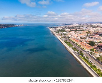 Aerial view Tagus river bank in Lisbon near Belem district. Tourism in Portugal concept