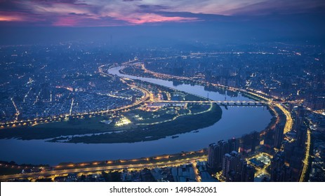 Aerial view of Taipei city - Asia business concept image, panoramic modern cityscape building bird's eye view use the drone at night, shot in Taipei, Taiwan.