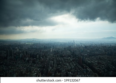 Aerial view of Taipei, Taiwan under a cloudy sky.
