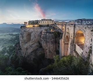 Aerial view of Tajo Gorge and Ronda Puente Nuevo Bridge at sunset - Ronda, Malaga Province, Andalusia, Spain