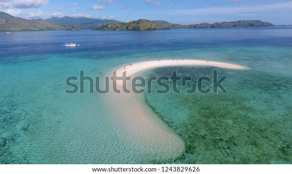 Aerial view of Taka Makassar sand island surounded by blue ocean in Komodo National Park, Flores East Nusa Tenggara, Indonesia