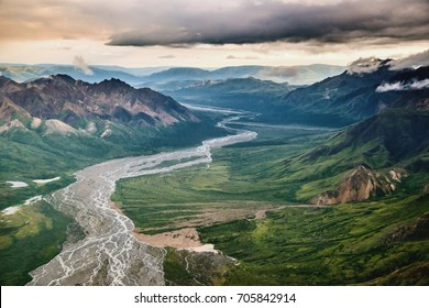 aerial view of talkeetna mountains and susitna river and valley in interior alaska, on rainy, cloudy summer day
