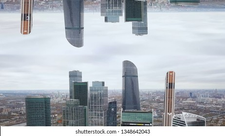 Aerial view of tall buildings and skyscrapers of a big city with mirror horizon effect. Beautiful skyscrapers with glass facade in New York, inception theme.