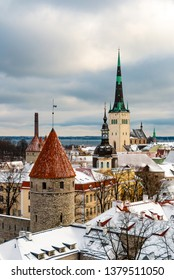 Aerial view of Tallinn city wall and St Olaf Church. Medieval old town in winter time. Capital of Estonia