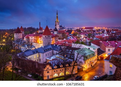 Aerial view of Tallinn Medieval Old Town illuminated in evening with dramatic sky, Estonia