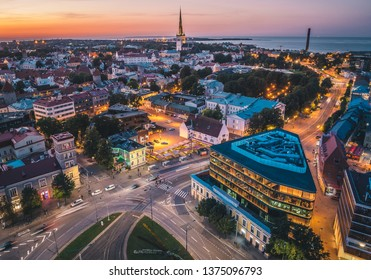 Aerial view of Tallinn Old Town and Baltic Sea at sunset. Summer evening in Estonia.