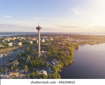 Aerial view of the Tampere city at sunset with colorful clouds
