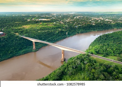 Aerial view of The Tancredo Neves Bridge, better known as Fraternity Bridge connecting Brazil and Argentina through the border over the Iguassu River, with the Argentinian city of Puerto Iguazu.