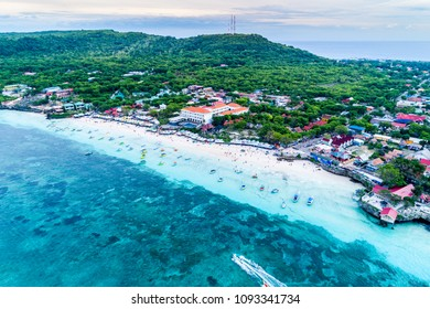 Aerial View of Tanjung Bira Beach, Sandy Beach with Tourists Swimming in Beautiful Clear Sea Water,  South Sulawesi Indonesia