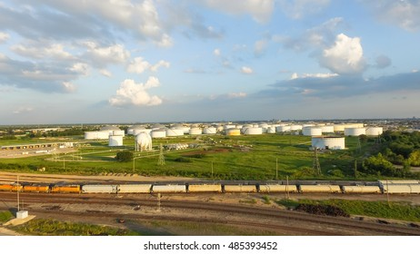Aerial view of tank farm for bulk petroleum and gasoline storage next to rail line from Northeast of Houston. Crude oil storage terminal, pipeline operations, distributes petroleum products. Panorama.