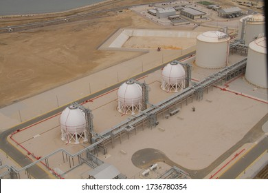 Aerial view of tank farm terminal with lots of oil storage tank and petrochemical storage tank in the harbour, Industrial tank storage aerial view